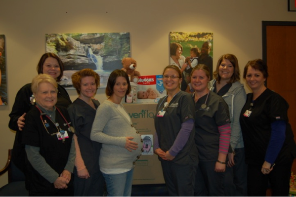 Pam Born (Far Right) poses with co-workers and one of their patients.